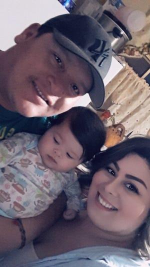 Salvador Valenzuela Carrizoza, Vanessa Miriles and their daughter.