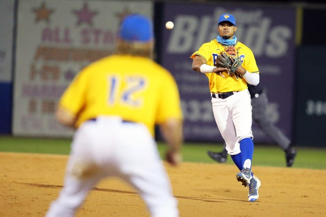 Canaries second baseman Alay Lago throws to first baseman Grant Kay during Sioux Falls' 5-3 win over Milwaukee in Game 4 of the American Association finals on Wednesday at the Birdcage.