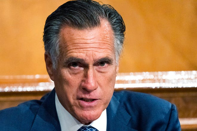 Sen. Mitt Romney, R-Utah, speaks during a meeting of the Senate Homeland Security and Governmental Affairs Committee. Romney said Tuesday that President Donald Trump's significant presence on social media and his ability to turn out the vote among his political supporters mean he isn't going away.