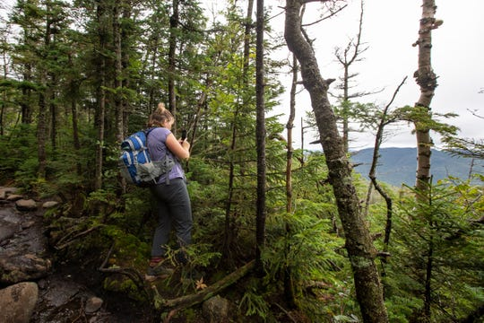 Katya Cassella, of Albany, stops to take a photo of the view while hiking to the summit of Algonquin Peak on Sunday, August 30, 2020.