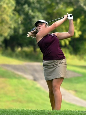 Elise Abrams, of John Glenn, hits a tee shot in a trimatch with visiting River View and West Muskingum at Cambridge Country Club.