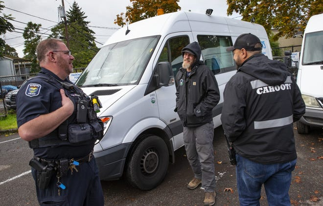 Eugene police officer Bo Rankin, from left, meets with CAHOOTS Administrative Coordinator Ben Brubaker and emergency crisis worker Matt Eads after working a shift together as part of the Community Outreach Response Team in Eugene.