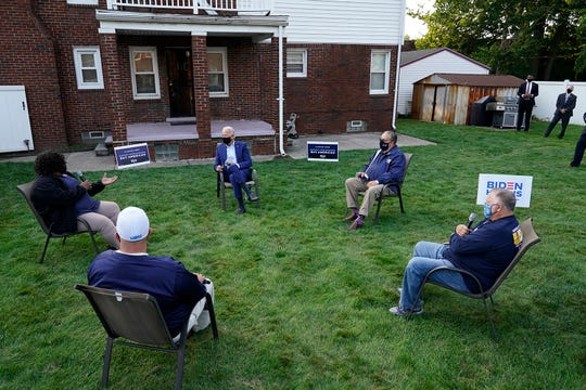 Democratic presidential candidate former Vice President Joe Biden listens during a campaign event with steelworkers in the backyard of a home in Detroit, on Sept. 9, 2020.