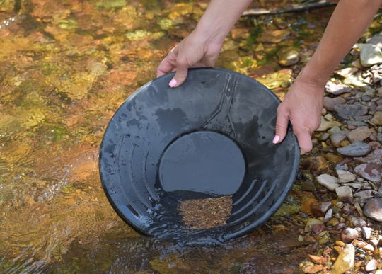 Gold prospecting is finding new fans as Americans look for new, socially-distanced hobbies that get them outdoors. Here, a prospector looks for gold in a shallow riverbed in Magpie Gulch in northern Montana. Writer Zoe Zorka breaks down the process.