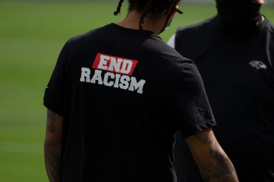 The 'End racism' shirt was designed by Houston Texans safety Michael Thomas (not pictured) worn by Baltimore Ravens players, among others, during pregame against Cleveland Browns at M&T Bank Stadium.