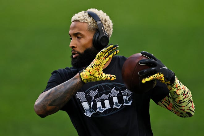 Cleveland Browns wide receiver Odell Beckham Jr. warms up before an NFL football game against the Cincinnati Bengals, Thursday, Sept. 17, 2020, in Cleveland. (AP Photo/Ron Schwane)