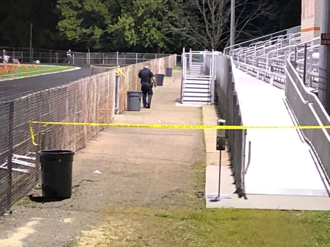 Akron police investigate a double shooting during a football game at Ellet Community Learning Center Thursday night.