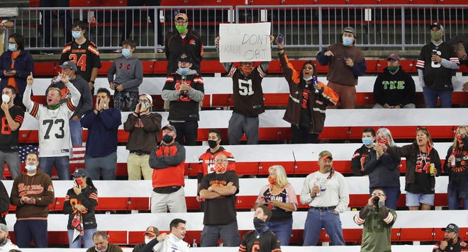 Browns fans celebrate after an Odell Beckham Jr touchdown during the second quarter of an NFL football game at FirstEnergy Stadium, Thursday, Sept. 17, 2020, in Cleveland, Ohio. [Jeff Lange/Beacon Journal]
