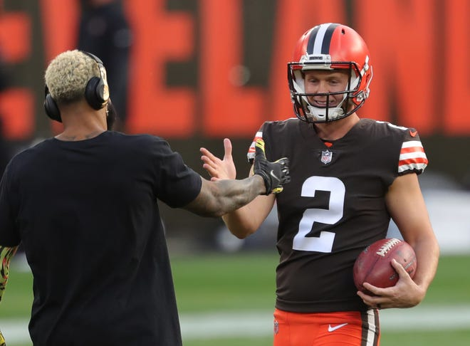 Cleveland Browns place kicker Cody Parkey (2) shakes hands with Cleveland Browns wide receiver Odell Beckham Jr. (13) before an NFL football game at FirstEnergy Stadium, Thursday, Sept. 17, 2020, in Cleveland, Ohio. [Jeff Lange/Beacon Journal]