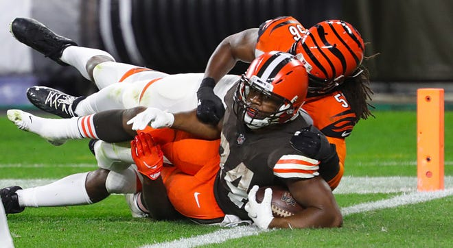 Browns running back Nick Chubb is brought down just short of the end zone by Cincinnati Bengals linebacker Josh Bynes during the third quarter on Sept. 17.