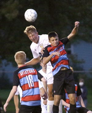 Alliance's Tommy Pasco, right, and Streetsboro's Ryan Thomson go for a header on a corner kick as Alliance's Nathan Simms (18) looks on during action at Alliance's Rockhill Soccer field on Thursday, Sept. 17, 2020.