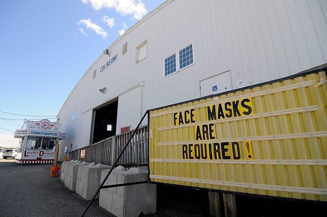 A sign in front of the Coliseum reminds fairgoers that Face Masks Are Required! is seen here on Friday. The 2020 Ashland County Fair opens on Sunday at 9 a.m.