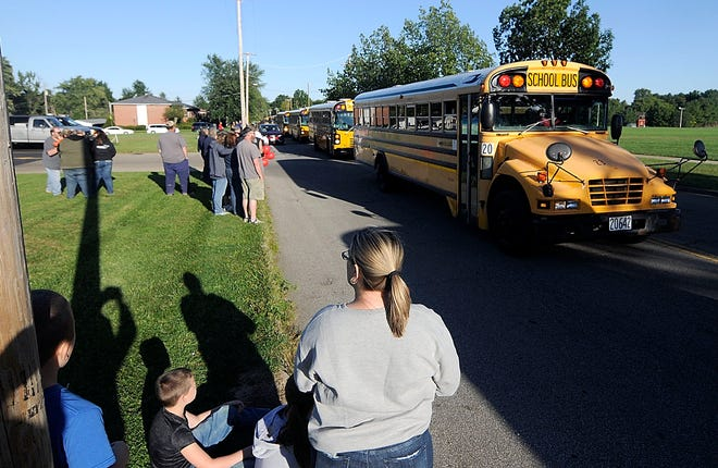 People watch the bus processional in memory of Dave McClure, Ashland City Schools head bus mechanic who passed away on Sept. 1 before the Ashland High School home football game.