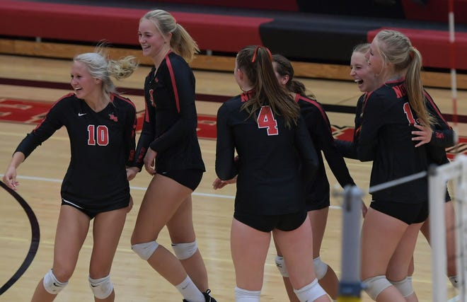 Members of the Roland-Story volleyball team celebrate after sweeping two-time defending Heart of Iowa Conference champion and eighth-ranked (Class 3A) Nevada Thursday in Story City. The win gave the No. 11 Norse a leg up in the HOIC title race.