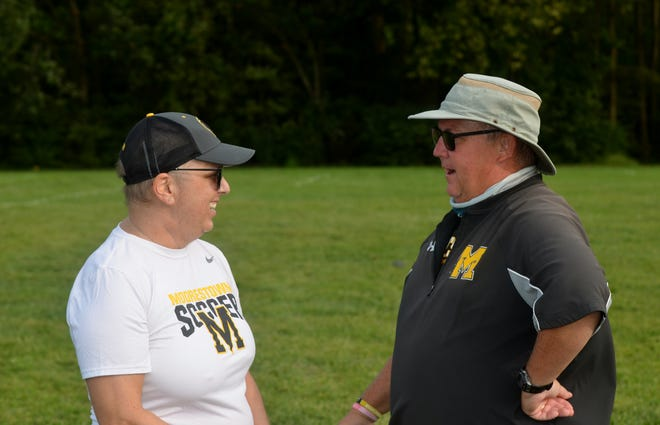 Moorestown freshman coach Steph Allocco and girls soccer coach Bill Mulvihill share a moment during a preseason practice.