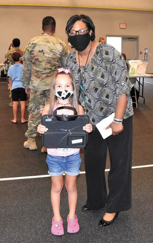 Dione Bradford, principal, Parkway Elementary School and the Louisiana Principal of the Year for 2021, visits with Sofia Borquez, 7, daughter of Sgt. 1st Class Manuel Borquez, 5th Battalion, 25th Field Artillery Regiment, 3rd Brigade Combat Team, 10th Mountain Division (Light Infantry), and Jasmine Borquez, Aug. 25.