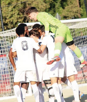 Oklahoma Wesleyan University goalie Alex Vidizzoni, top, celebrates a happy moment with his teammates during 2019 men's soccer season play in Bartlesville.