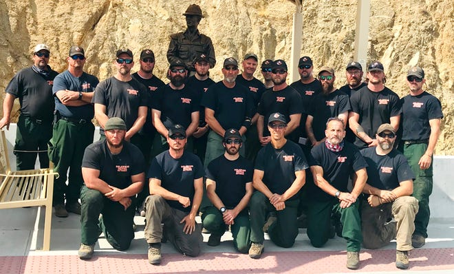 """Delaware's wildfire crew visits the Granite Mountain Hotshots Memorial Park in Yarnell, Arizona, which commemorates 19 firefighters lost in the 2013 Yarnell Hill Fire featured in the 2017 film, """"Only the Brave."""" Front row. from left: Edward Boyer of Ellendale, Sam Topper of Maryland, Connor Terry of Virginia, David Pro of Newark, Mark Kammer of Magnolia and Todd Shaffer of Maryland. Back row, from left: Mark Lasocha of Dover, Scott Veasey of Millsboro, Bart Wilson of Wilmington, Brian Jennings of Harrington, Adam Keever of Newark, Christopher Valenti of Dover, James Charney of Felton, Michael Valenti of Dover, Robert Young of Townsend, Bradley Melson of Milford, Nathan Shampine of Hockessin, Zachary Brown of Harbeson, William Seybold of Dover, Hunter Melson of Milford and Erich Burkentine of Milton."""