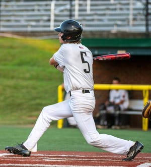 Randolph County's Blake Marsh hits a two-run homer against Davidson County in a NC3 league game at McCrary park in Asheboro on July 26.