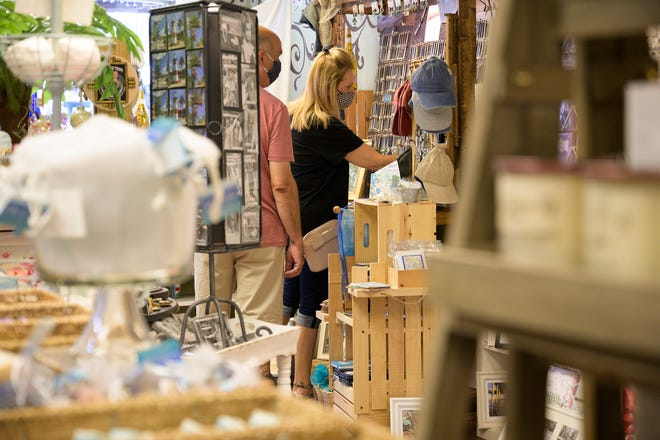 People shop around at Under the Cherry Blossoms in Downtown Mount Dora. [Cindy Sharp/Correspondent]