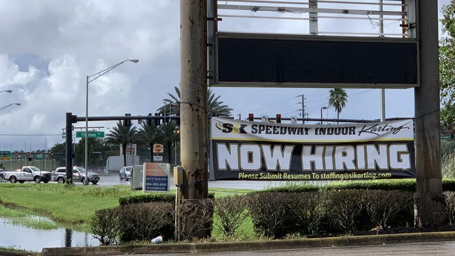 A hiring banner can be seen for SIK Speedway Indoor Karting in the former Toys 'R' Us along West International Speedway Boulevard, just west of Williamson Boulevard, in Daytona Beach on Friday, Sept. 11, 2020.