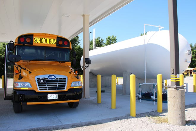 One of the Independence School District's propane-powered buses refuels at the district's transportation center. The district started using 10 propane-powered buses during the summer and believes it could save $10,000 in fuel this school year.