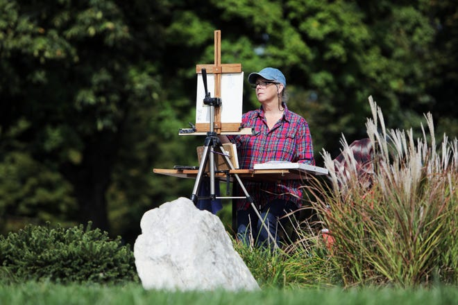 Gin Lammert of Pulaski uses with soft pastels for her work in the 2020 Plein Air Event Friday in Crapo Park in Burlington. The event is put on by the Crapo Park Foundation and 21 artist were at Crapo Park Friday and Saturday working in a variety of mediums. The final works were judge Saturday at the Art Center of Burlington.