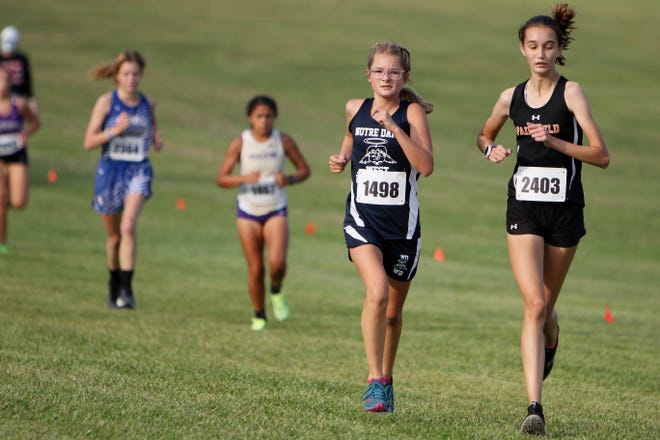 Notre Dame-West Burlington's Hadley Augustine and Fairfield's Malena Bloomquist compete during the running of the 49th annual Timm Lamb Invitational, Thursday Sept. 17, 2020 at Fort Madison Middle School.