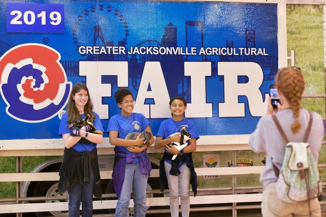 The organization putting on the annual Jacksonville Fair cancelled this year's event because of the COVID-19 pandemic. In this file photo, Future Farmers of America advisor Karyn Chester (right) photographs Camden County Middle School members during the 2019 fair.