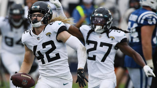 Jaguars safety Andrew Wingard celebrates his first NFL interception with teammate Chris Claybrooks during last Sunday's 27-20 victory over Indianapolis, at TIAA Bank Field.