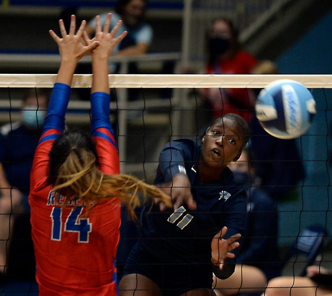 Dorman played Byrnes in high school volleyball at Dorman High School on Sept. 17. Byrnes' Rachel Anderson (14), left, at net with Dorman's Lauren Mims (11).