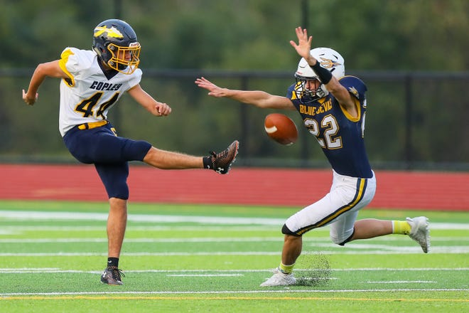 Tallmadge senior San Taylor blocks a punt during the first half of Talmmadge's 47-14 home loss to Copley Sept. 17.