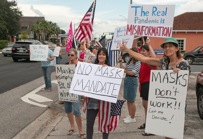 Anti-mask protesters including Ann Raubolt, center, demonstrate along South Florida Avenue on Sept. 6, the day before the Lakeland City Commission voted to extend the city's face mask mandate. That ordinance was allowed to expire on Oct. 5.