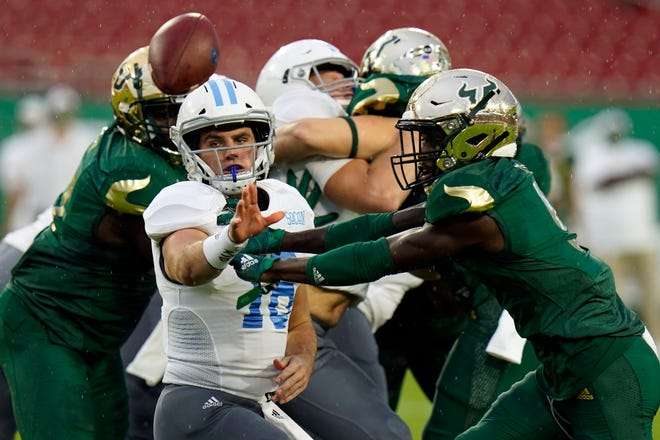 Citadel quarterback Brandon Rainey pitches the ball as he is pressured by South Florida defensive back KJ Sails during the first half of the Bulls' victory last Saturday.