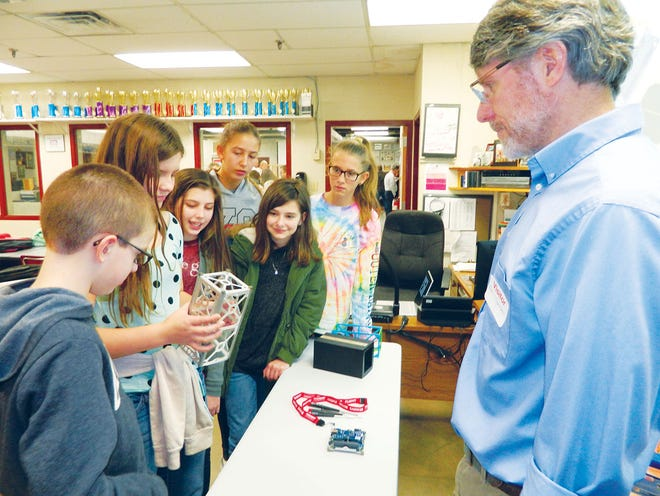 In this December 2018 file photo by Ben Pounds, Peter Thornton, at right, a senior research scientist at Oak Ridge National Laboratory, presents components of the RamSat satellite to students, including an aluminum framework.  - 2891c342 c4e3 466b 9c29 02569cfcb31f RAMSAT donation - Students' satellite set for launch into space on Thursday
