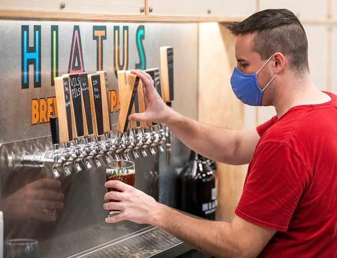 Adam Chapman pours a beer at Hiatus Brewing Co. on Monday after the state allowed bars to reopen. Marion County posted an unemployment rate of 6.3% in August, nearly half the 12.1% rate at the height of the COVID-19 shutdowns in April.
