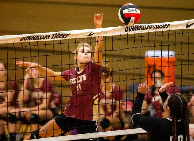 North Marion's Shea Lopez tips one over the net in the second set. The Colts defeated the Dunnellon Tigers in three straight sets Thursday night, 25-14, 25-9, 25-7.