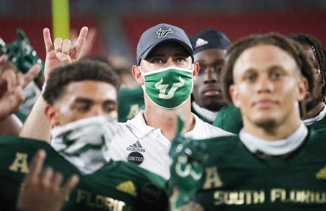 South Florida coach Jeff Scott celebrates with his team after the Bulls defeated Citadel in Tampa in the season opener. USF had to halt practices and postpone its game against FAU this week because several Notre Dame players tested positive for COVID-19 after their game Saturday.