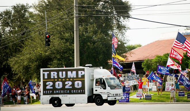 Supporters of President Donald Trump gather at  intersection of PGA Boulevard and Military Trail Friday September 18, 2020 in Palm Beach Gardens. The group has been gathering at the same location since 2016. [MEGHAN MCCARTHY/palmbeachpost.com]