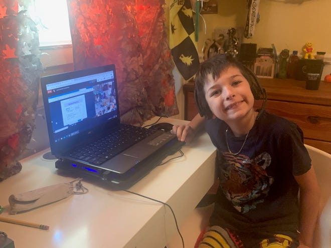 Nicolas Serra, 8, of The Acreage will remain at home and attend Loxahatchee Groves Elementary School virtually when some of his other classmates return to the brick-and-mortar school on Monday. Nicolas' mother, Laurel Serra, said her son won't return yet because he has asthma and is at high risk for COVID-19.