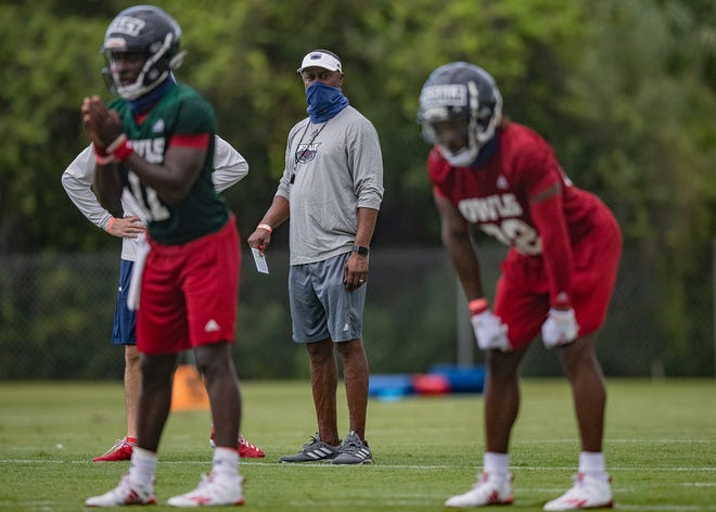 Willie Taggart, watching a Florida Atlantic training camp practice in August, will have to wait another week to make his head coaching debut for the Owls. FAU photo