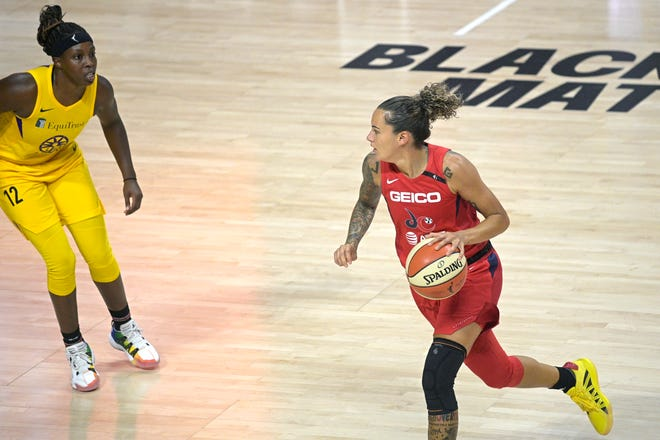 Washington Mystics guard Jacki Gemelos, right, brings the ball up the court in front of Los Angeles Sparks guard Chelsea Gray (12) in Bradenton, Fla. Gray and Gemelos are both gruates of St. Mary's High School in Stockton.