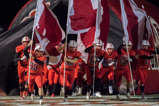 The Ripon Indians take the field at the start of the CIF Divison IV-AA football state championship game against the Highland Biulldogs at Ripon High School. [CLIFFORD OTO/THE STOCKTON RECORD]