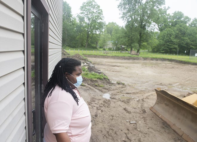 Progress of the King Kennedy Community Center gym. Myia Sanders, KKCC Program manager, looks out onto the site of the gym.
