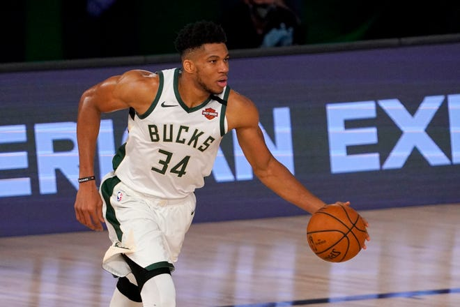 Milwaukee's Giannis Antetokounmpo joined Michael Jordan and Hakeem Olajuwon as the only players to be named NBA MVP and Defensive Player of the Year in the same season.