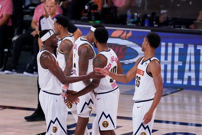 Denver Nuggets players celebrate Tuesday's win over the Los Angeles Clippers that moved the Nuggets into the Western Conference finals. Denver will play the Los Angeles Lakers on Friday night.
