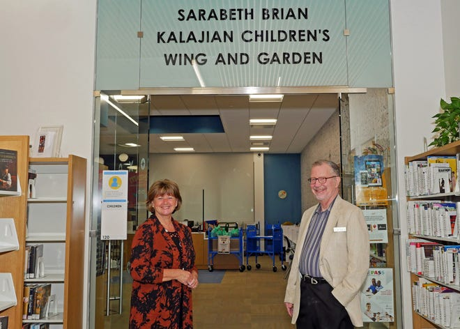Sarabeth Kalajian and William H. Jervey Jr. pose in front of the newly named Sarabeth Brian Kalajian Children's Wing and Garden at the William H. Jervey Jr. Venice Public Library in Venice. Kalajian, who retired as director of Sarasota County Libraries and Historical Resources in October 2019, started as youth services librarian at the old Venice Public Library in 1984.