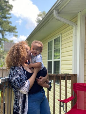 Raven Coots poses with her son, 1-year-old Roman Coles. She donated the umbilical cord when Roman was born last year to the Be the Match stem cell registry. Raven is biracial, which makes her stem cells especially useful to people who might find it hard to find a match on the registry. [COURTESY OF RAVEN COOTS]