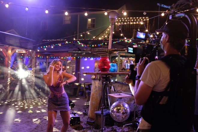 "Madelyn Cline dances at The Fat Pelican in Carolina Beach, as Lighthouse Films' Brad Walker films a scene for the Kygo ""Hot Stuff"" music video. [PHOTO COURTESY OF LIGHTHOUSE FILMS]"