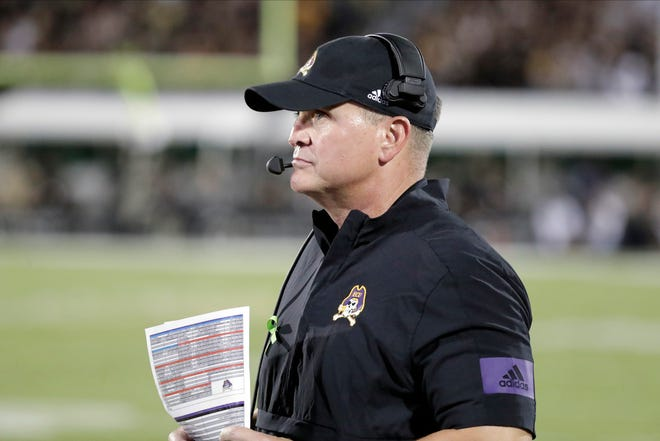East Carolina head coach Mike Houston said his team is in high spirits heading into its first game week. [AP FILE PHOTO]